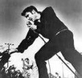 "Elvis Presley---died1977--- A Rock & Roll hall of Fame Inductee, Country Music Hall of Fame Inductee and Gospel Music Hall of Fame Inductee.  Called ""The King"". You can't have the Rock & Roll Heaven choir without Elvis."