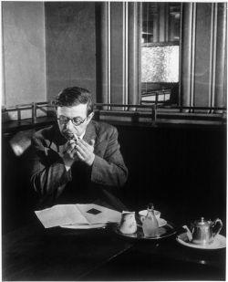 Jean-Paul Sartre at Café de Flore, 1945 (0rchid-thief.livejournal.com)