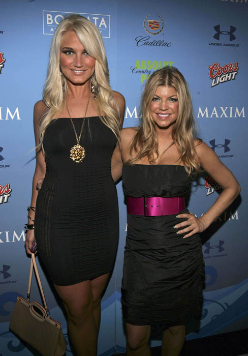 A 5'11 Brooke Hogan standing next to a petite 5'2 Fergie.