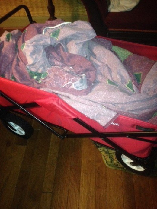I always have a hard time carrying the laundry basket from the bedrooms down the hall to the laundry room.  My foldable wagon sure is a great help.  I can strip the beds and throw the linens in the wagon and off I go to the laundry room.