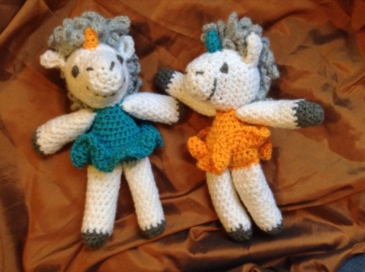 Crochet amigurumi ballerina unicorn stuffed animal dolls.