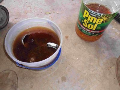 A simple solution of Pine-Sol and hot water for cleaning your parts.