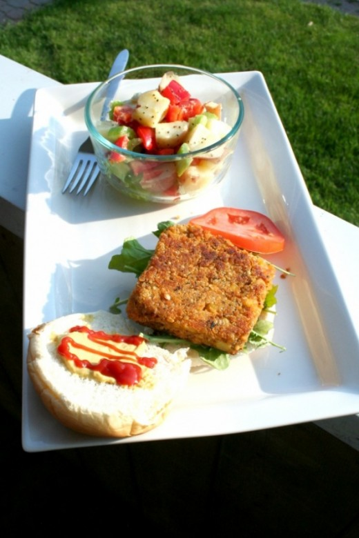 Gluten-free vegan quinoa burgers with potato salad