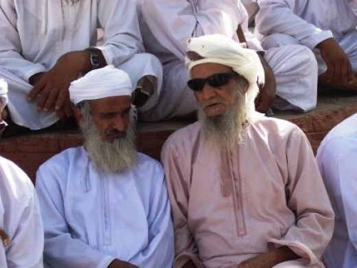 Old Oman men talking