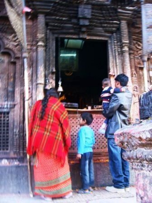 Family worshipping in the temple