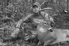 MAN AND WHITE TAIL DEER
