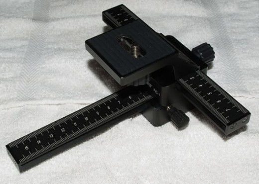 The focusing rail attaches to your tripod and the camera attaches on top of the focusing rail.