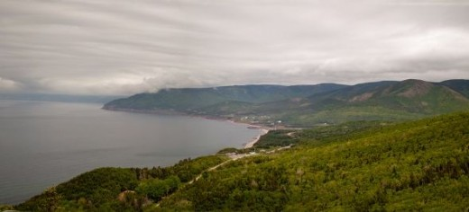 This is a panorama photograph showing the mountains along the shore on the eastern portion of the loop..