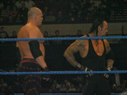 The Undertaker and his half brother Kane have been both partners and feuded with each other. Both are huge men.