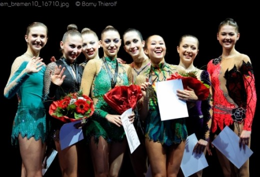 Top gymnasts (including rivkin) pose for a picture at the london games.