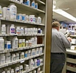 prescription drugs on a pharmacy shelf [Tim Boyle - Getty Images]