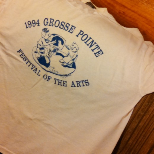 The t-shirt from the art festival where my uncle's pottery was featured. He loves making pottery pigs and other animals!