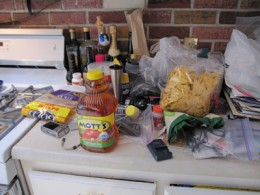 An example of why my mother complains I need someone to clean my cluttered house. Hey look; there's the camera that got killed by my diet shake. Read that story if you haven't already.