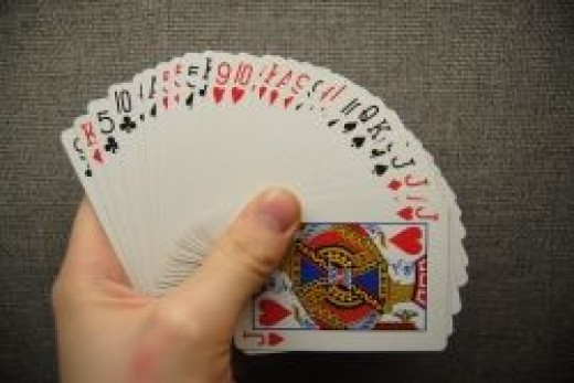 A fanned euchre deck and score cards