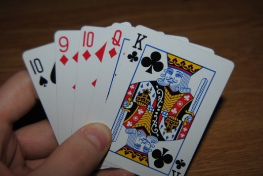 You have three diamonds, but they're the three lowest in the deck and your off cards aren't very strong. You should pass this hand.