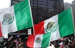 Three Mexican flags in a stiff breeze. Photo by Michael L. Dorn.