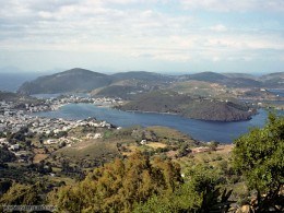 Patmos. an island located on the eastern border of the Aegean Sea. It is often battered by winds from the North. The sun shines on Patmos most of the year.