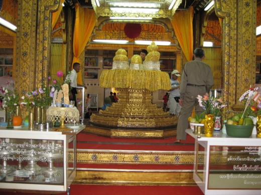 The devotees place a golden leaf and images of Buddha.  Each image has become a ball of gold.