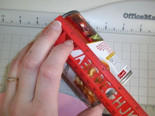 Measure the height of your can or dowel and cut a piece of paper to fit.