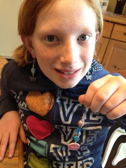 With help, kids love making their own jewelry!