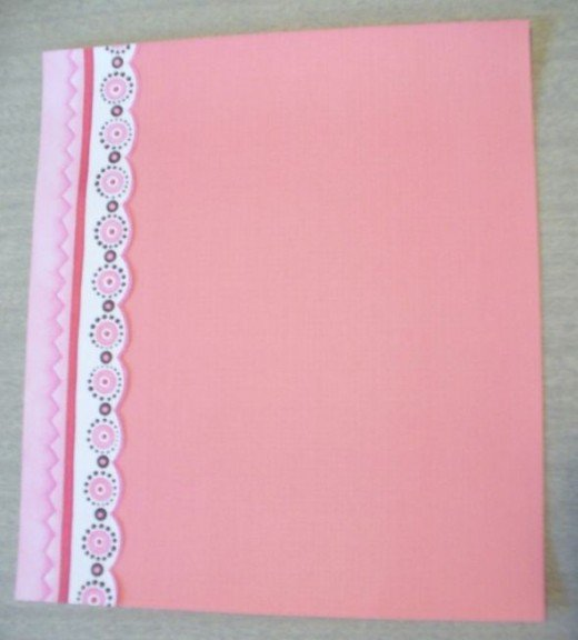 First I cut out a border from patterned paper.