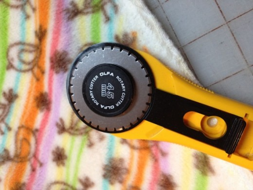 The perforated rotary blade will help you cut a dashed line near the edge of the fleece so you can crochet through it.