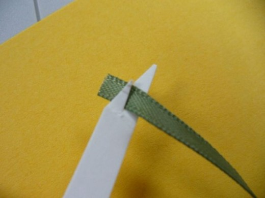 5. This shows the ribbon inserted in the ribbon threading jig.