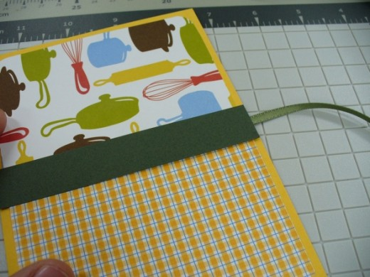 Once you decorate the cover you won't see the ribbon tail.  Here's the finished cover from the front side.
