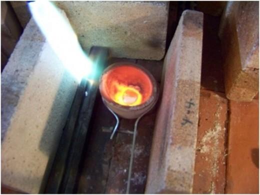 molten metal, metal blob, silver metal blob, casting metal, metal ingot, make an ingot, cast an ingot,