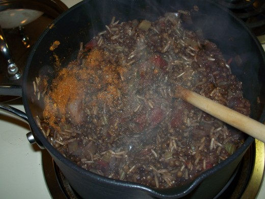 After thirty minutes, stir in spices.  Then, cook until lentils are tender.