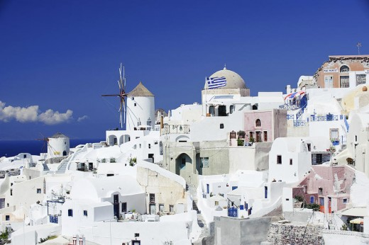 Santorini is essentially what remains after an enormous volcanic eruption that destroyed the earliest settlements on a formerly single island.