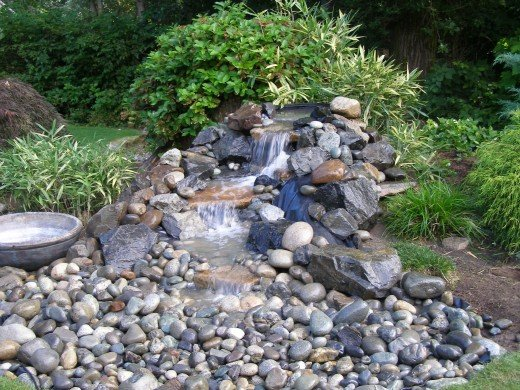 Ponds and waterfalls add interest for Build your own waterfall pond