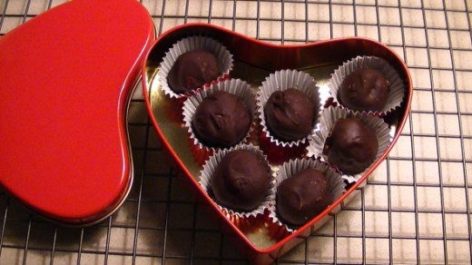 For Valentine`s Day a heart tin with Cookie Dough Truffles makes a healthy gift.