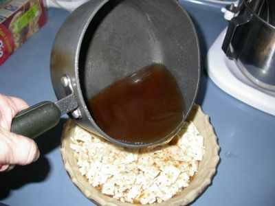 Adding the Magic Syrup to the crackers