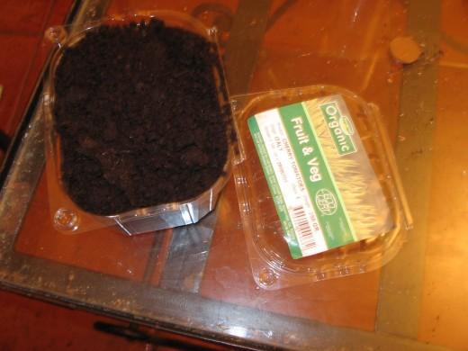 earth in a plastic pot copyright: tiggered