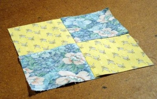 Completed Four Patch block in contrasting fabrics