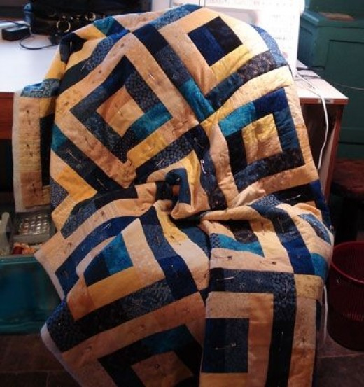 Margaret's blue and gold scrap quilt Partly quilted in this photo