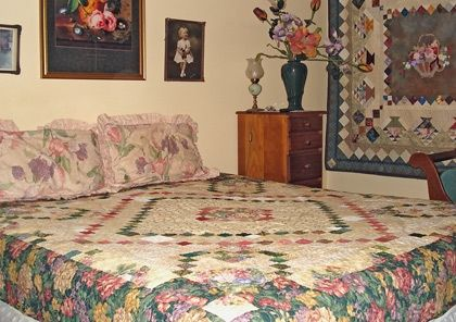 Quilts on Jan T's bed and wall