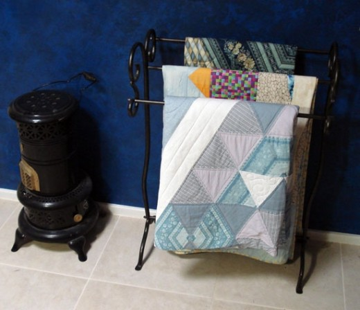 Hang quilts on a beautiful towel rail