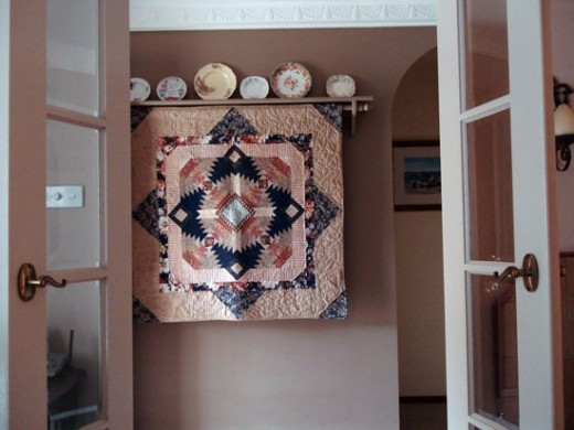 Hang quilts on special racks