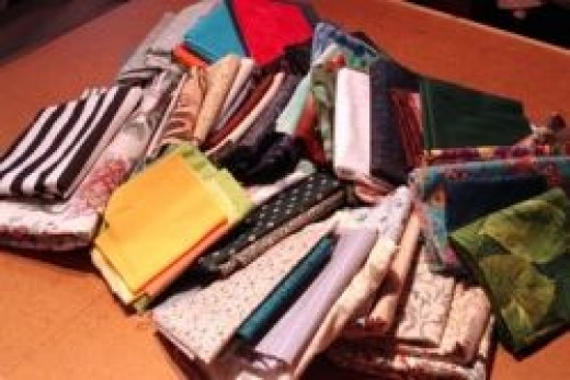 A pile of fabric on my studio cutting table