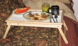 Pancakes, papaya, juice and coffee ready to serve my wife breakfast in bed.