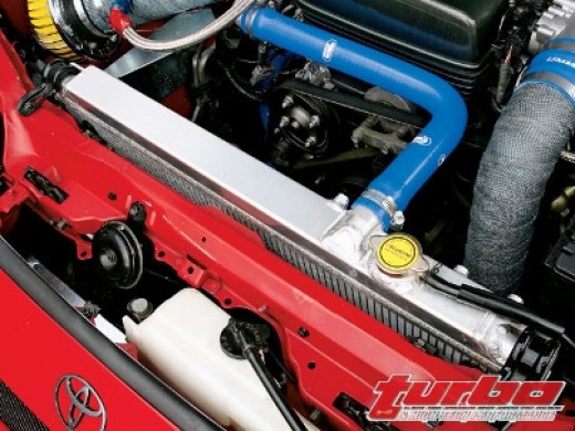 You can find your radiator located at the front of your engine as pictured here.