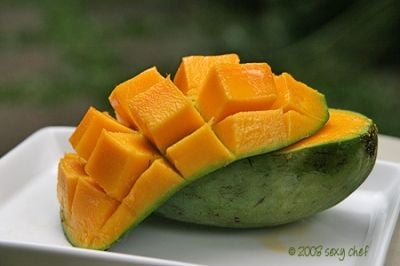 "The ""hedgehog"" style is a common way of eating mangoes."