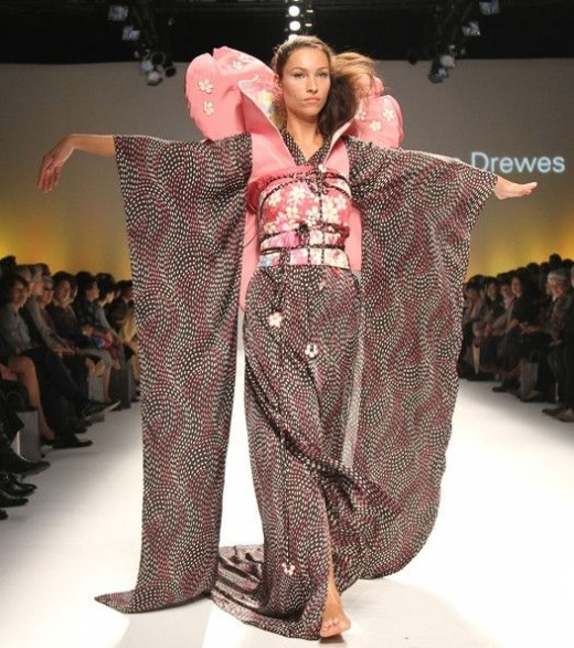 Model in a fashion show wearing modernize Kimono dress.