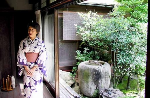 Japanese woman in Kimono in the garden.