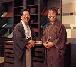 Two Japanese men wearing traditional Kimonos.