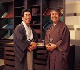 Two Japanese men wearing traditional Kimonos.