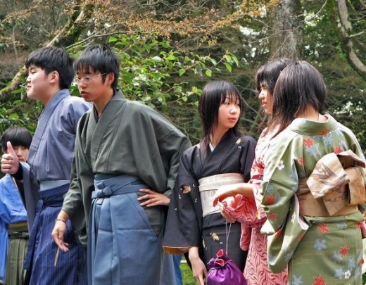 At Kinkakuji (The Golden Pavilion) in Kyoto spotted a group of kids wearing traditional Kimonos.