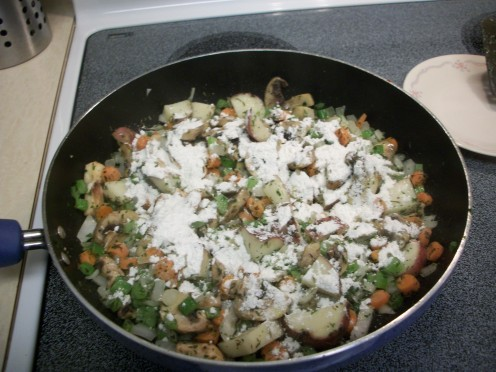 Sprinkle the flour over the vegetables and cook for 5 minutes.